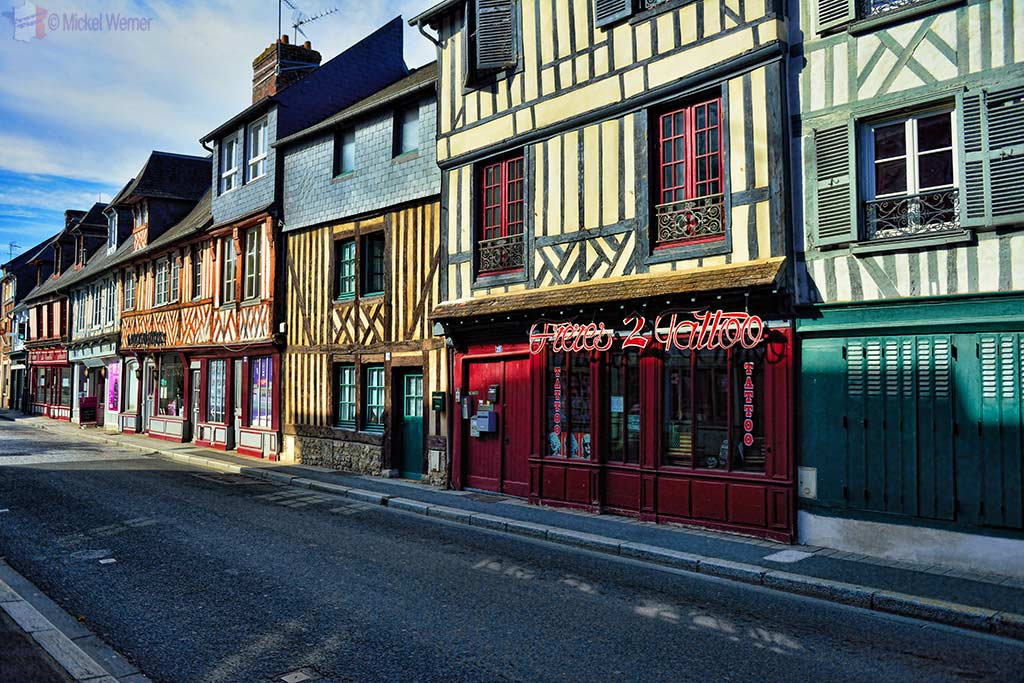 """Small shops inside """"old"""" Normandy-style houses in Pont l'Eveque"""