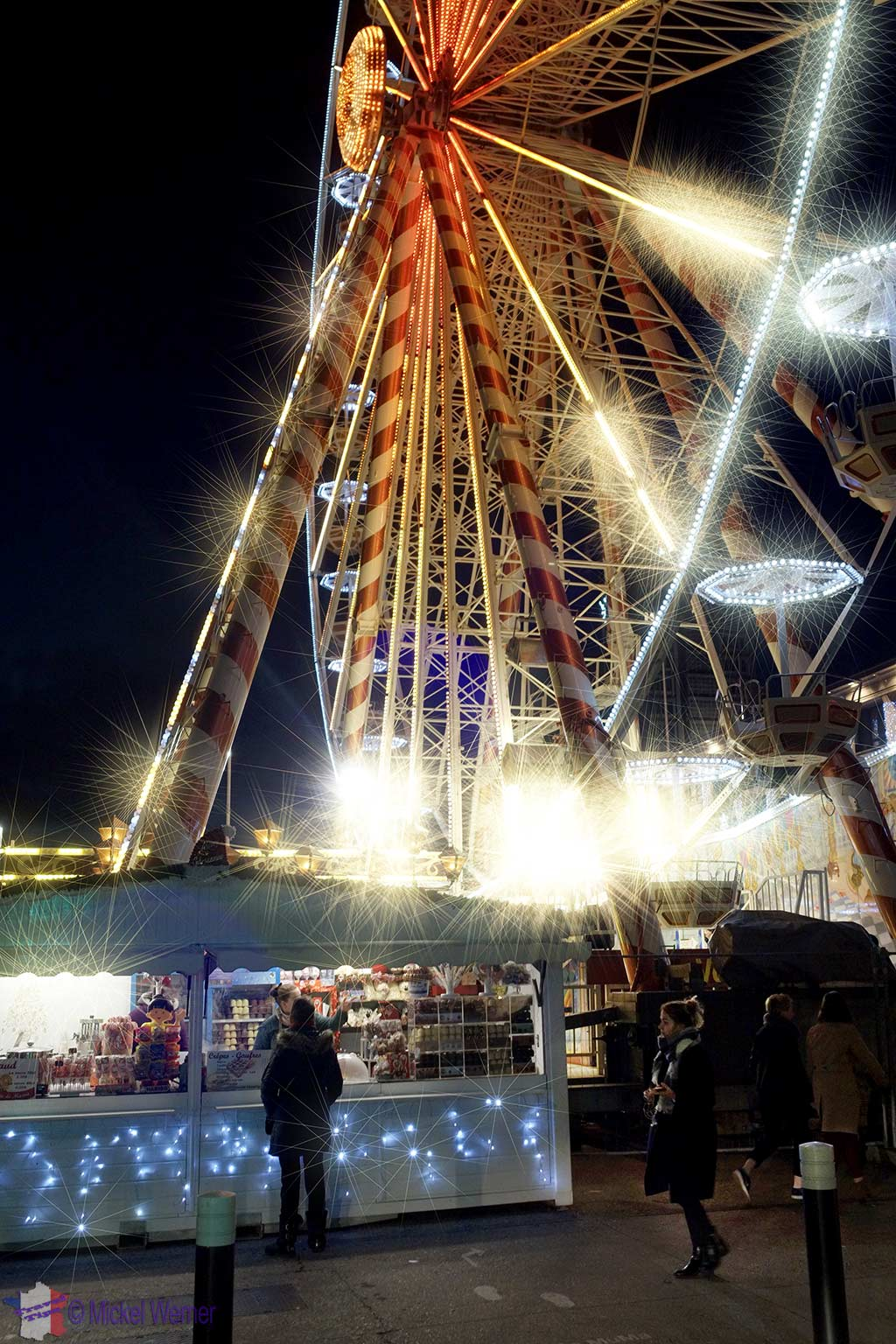 Ferris wheel and Christmas market huts in front of the Mairie of Le Havre, Normandy