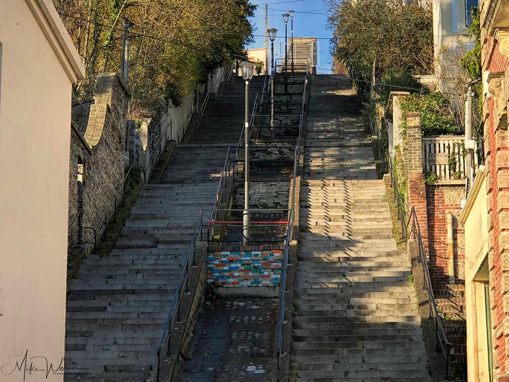 """The bottom part of the """"Escalier de Montmorcency"""" used to be the main stairs which workers took to go downtown. Two side separated by an escalator."""
