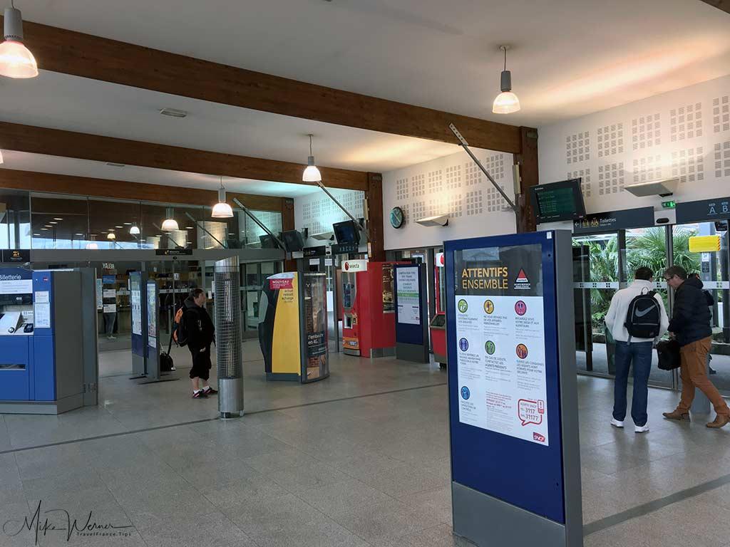 Ticketing machines inside a French railway station