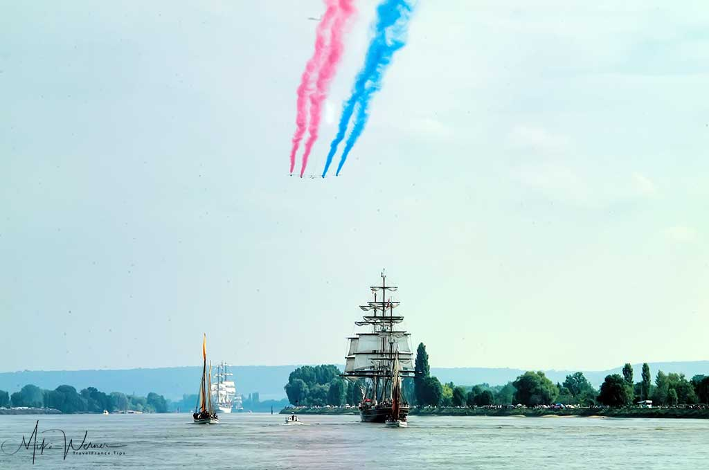 The Patrouille de France military stunt team fly over the exodus of the Armada.