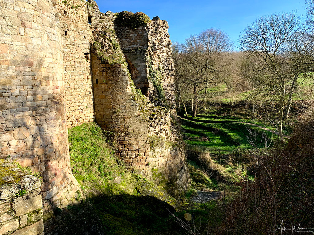 Large moats of the Guildo Fortress ruins in Saint-Jacut-de-la-Mer.