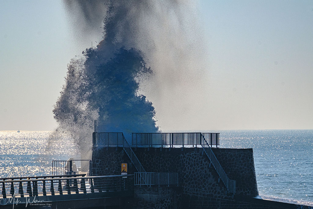 Massive waves hit the seawall and lighthouse in Les Sables-d'Olonne