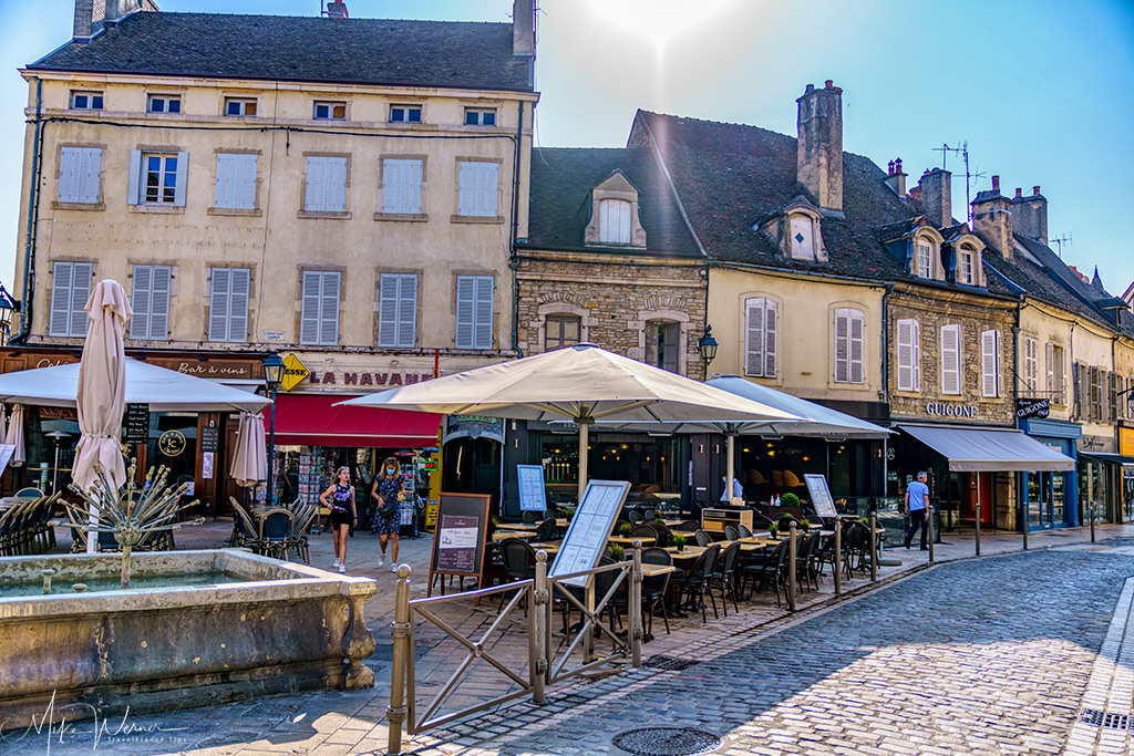 Cobblestone street with terraces in Beaune