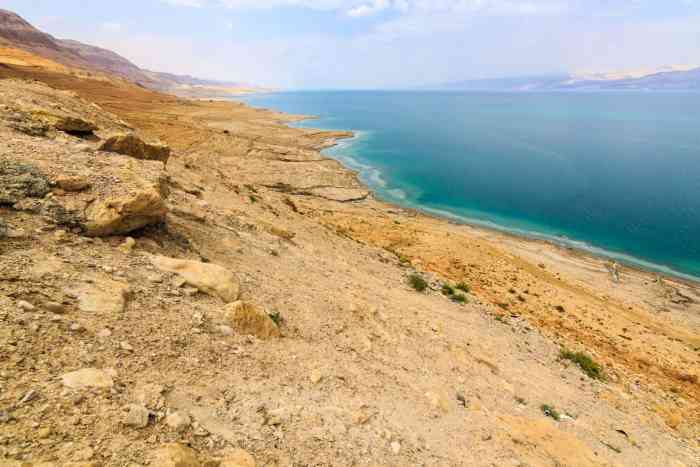 Toasted land next to the turquoise Dead Sea