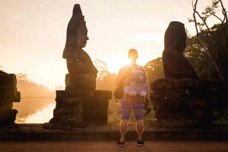 Standing on the bridge at the South Gate of Angkor Thom.