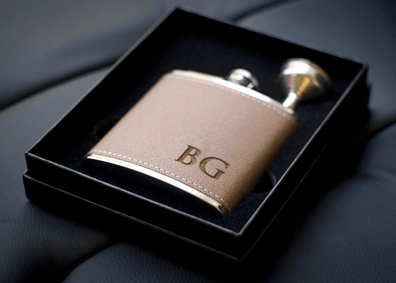 monogrammed flask as a travel gift for him