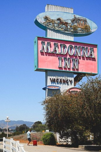Dwarfed by the roadside sign for The Madonna Inn on the Pacific Coast Highway