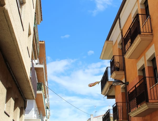 postcards from a Costa Brava street with a flag flying