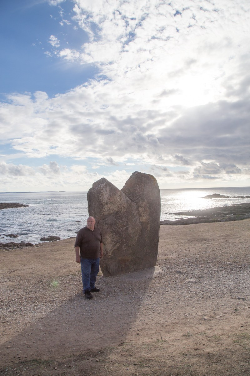 Dan Burgoyne standing at the Ber er Goalennac heart-shaped menhir - Brittany