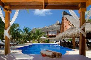 El Dorado Maroma Beach bed by the pool