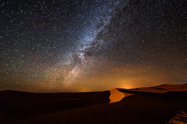 Starry night sky over Sahara desert