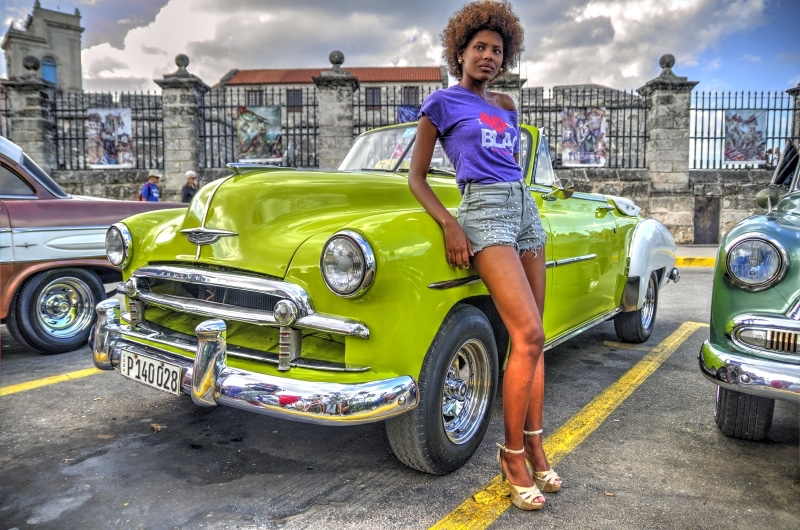 Havana, Cuba - model on classic car