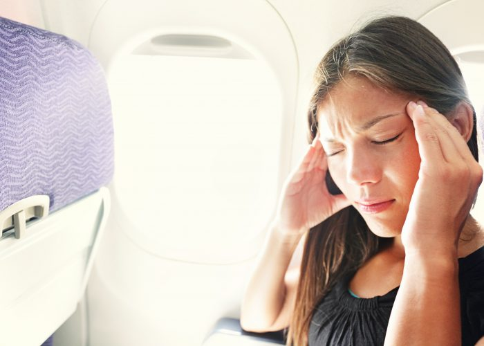 Women on plane feeling sick
