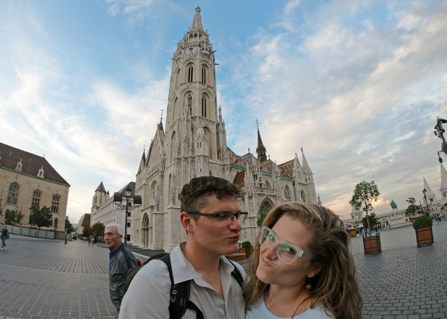 Brittany and Steve in from of Matthias Church in Budapest, Hungary. @travelingintandem