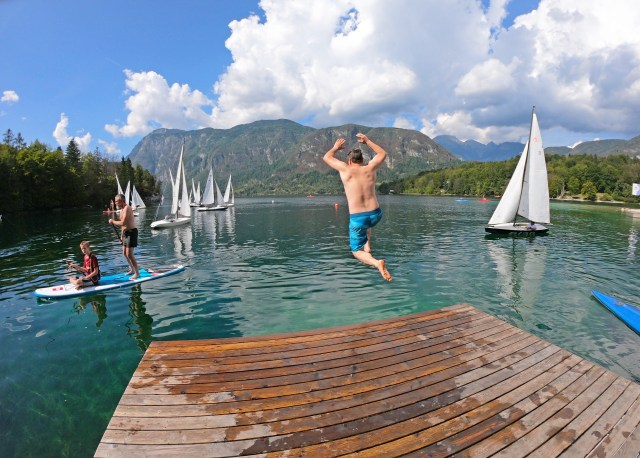 A GoPro shot of Steve jumping into Lake Bohinj. by @ travelingintandem