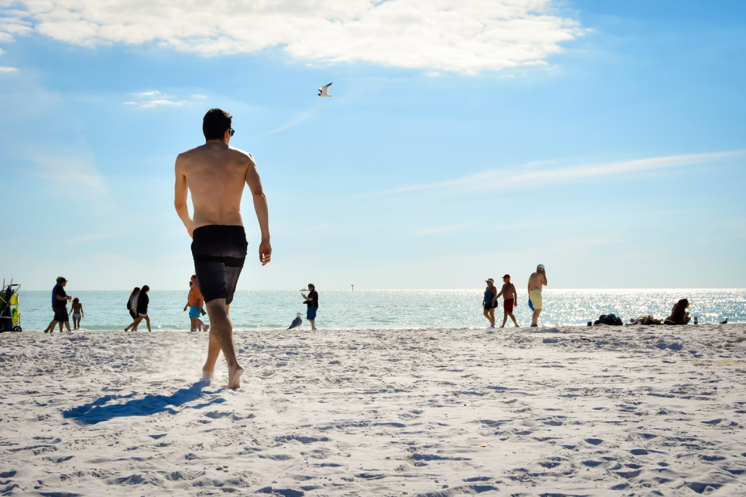 Man Swimmer on beach in Sarasota Florida