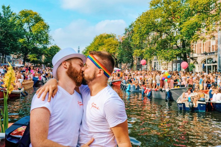 Couple of Men kiss during Amsterdam Pride