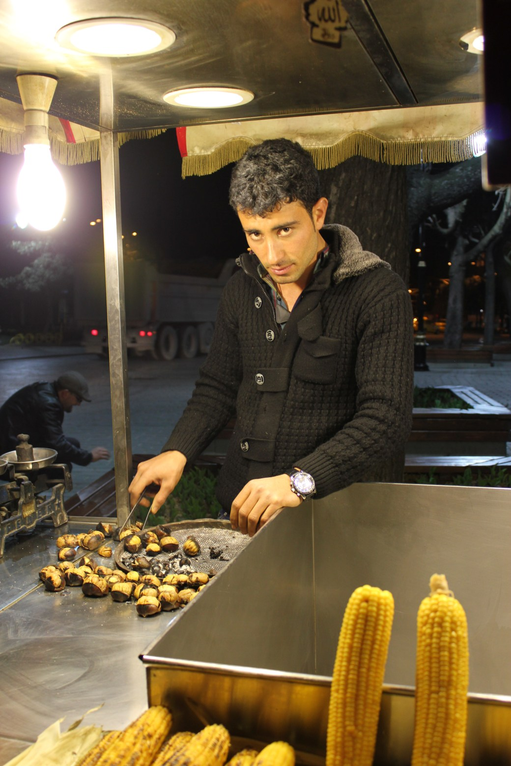 Cute Guy Roasting Chestnuts; Istanbul, Turkey; 2013