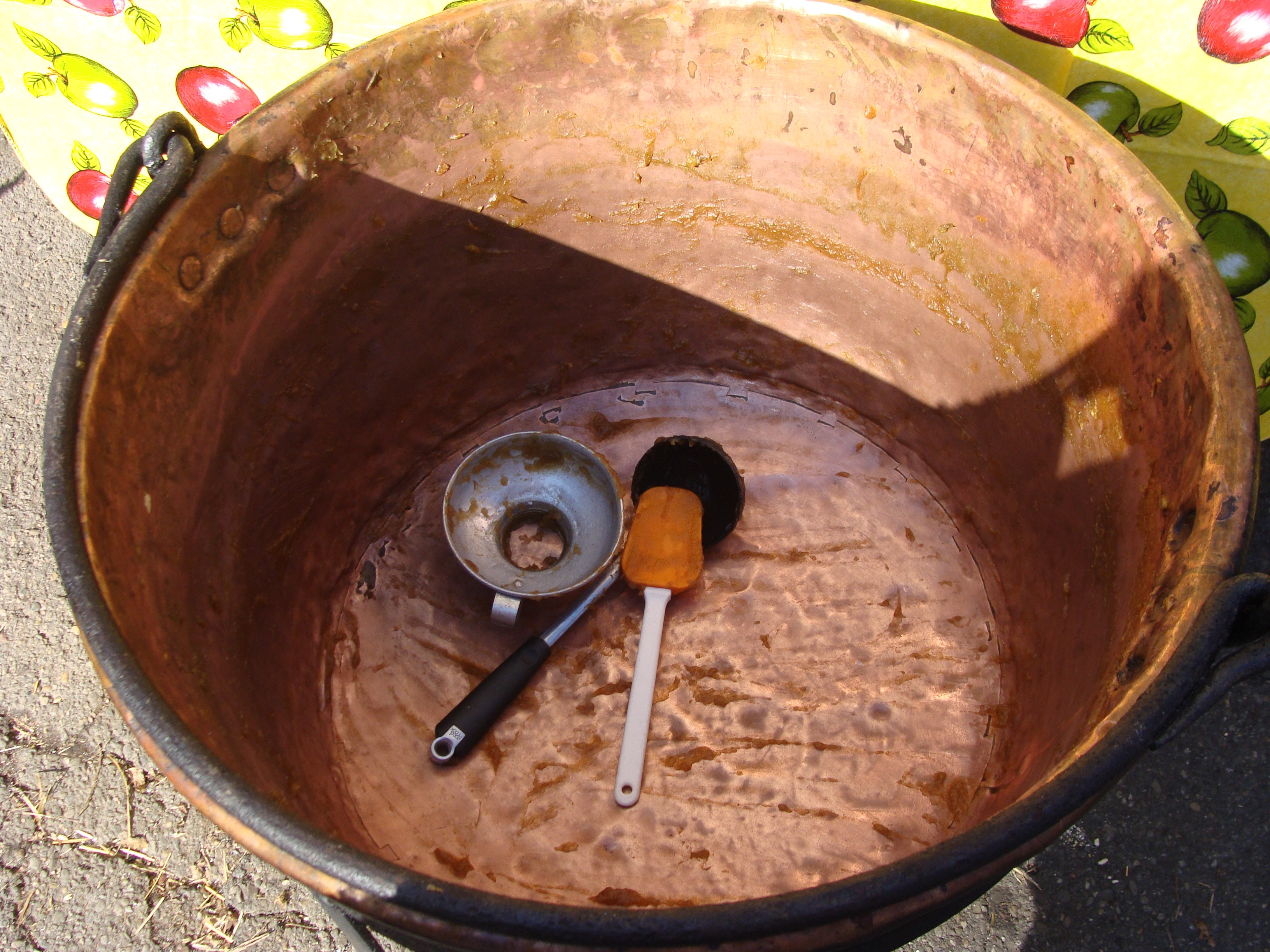 empty old fashioned apple butter kettle outdoor cooking