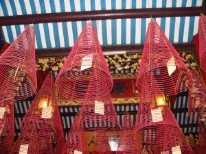 prayer cards in incense cones hanging Viet Nam