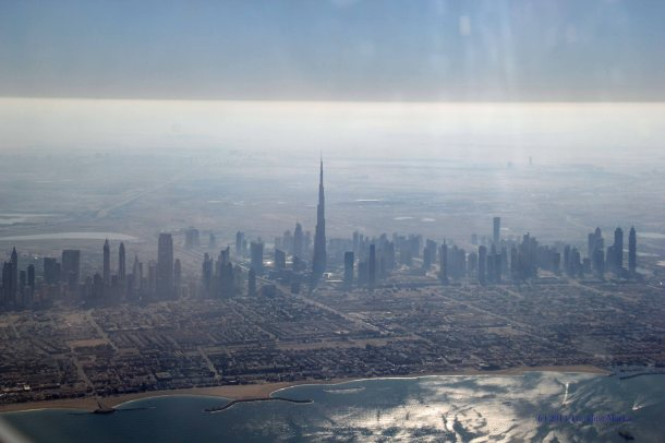 Aerial view of Dubai along the Arabian Gulf. Seriously...just look at the height of this building compared to the rest of the city!