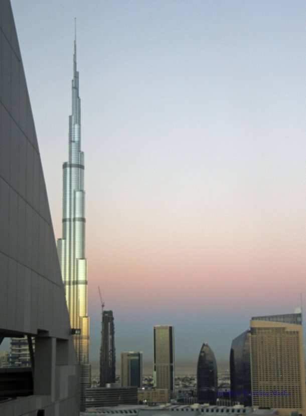 Sunrise and the Burj Khalifa, as seen from the 26th floor of the Radisson Blu Downtown Dubai