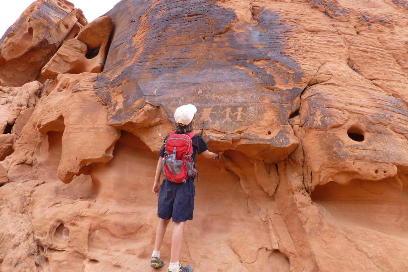 Hiking in the Valley of Fire with petroglyphs. No one really knows the valley of fire petroglyphs meaning.
