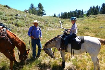 Horseback riding in Yellowstone National Park with Wilderness Pack Trips Mike Thompson with elk antler