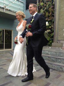 Bride and groom walk down steps