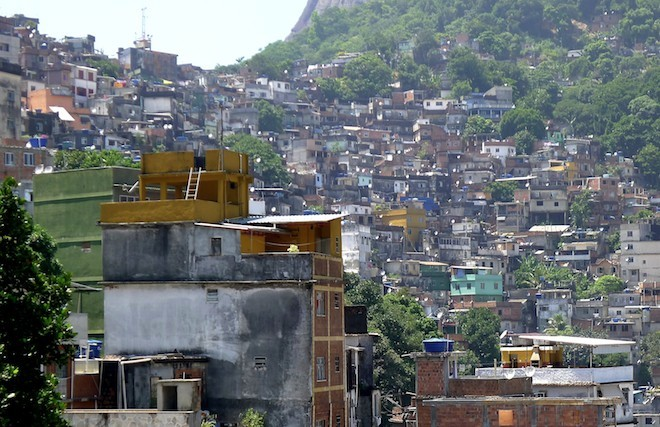 Tourists alongside with drug runners in Rio's favelas