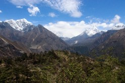 First View of Everest Shrouded Behind White Clouds (Day 2 of Hike)