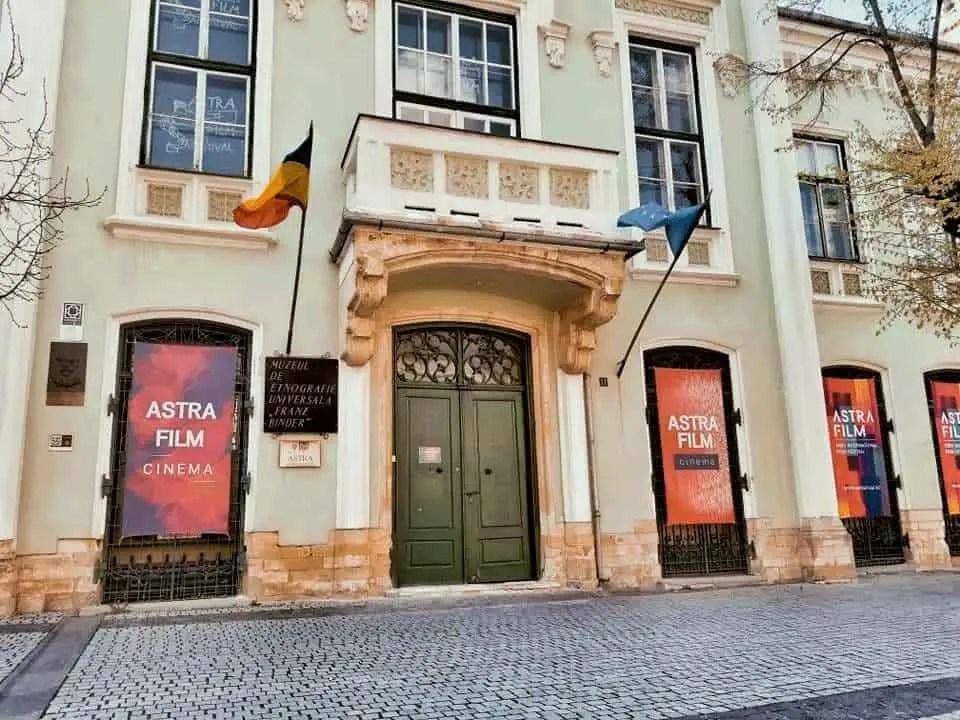 Building in Piata Mica with signs for Astra Film Festival in Sibiu, Romania