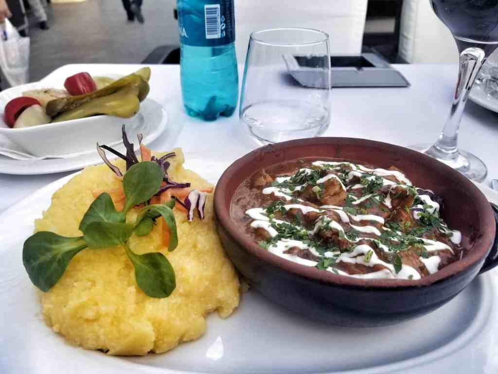 where to eat in sibiu - pork stew and polenta with pickles