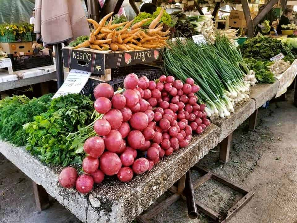 Tables filled with fresh vegetables at the Farmer's Market in Sibiu, Romania