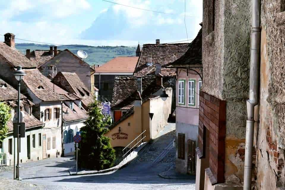 Sibiu's quaint lower town, with mountain ridges seen on the far horizon.
