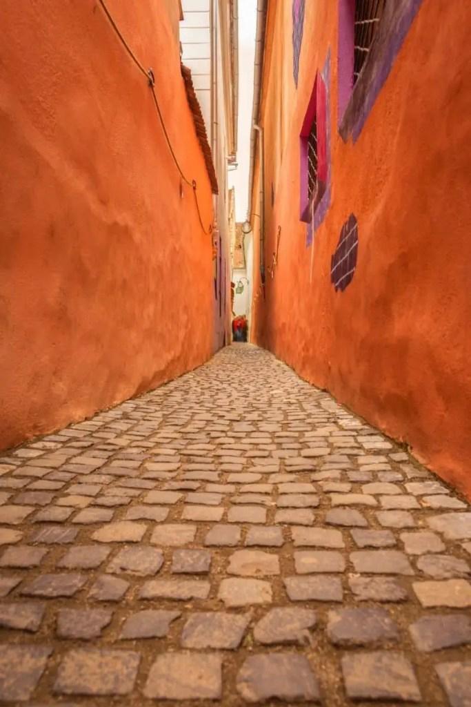 Strada Sforii, the narrowest street in Europe, in Brasov, Transylvania, Romania.