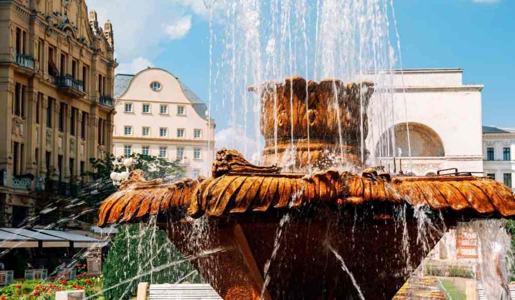 Close-up of fish fountain in Victoriei Square, one of the best places to visit in Timisoara.