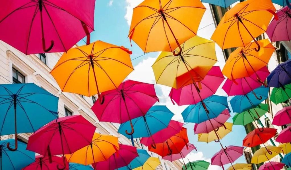 Colorful umbrellas overhead on Strada Alba Iulia in Timisoara, Romania.