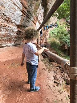 Toddler walking up Emerald Pool Trail-Zion National Park