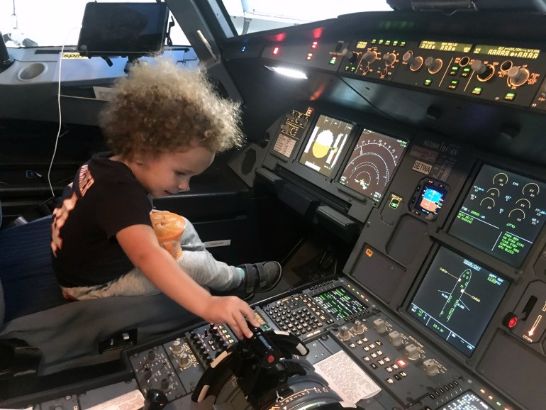 Toddler in cockpit flying Spirit Airlines airplane
