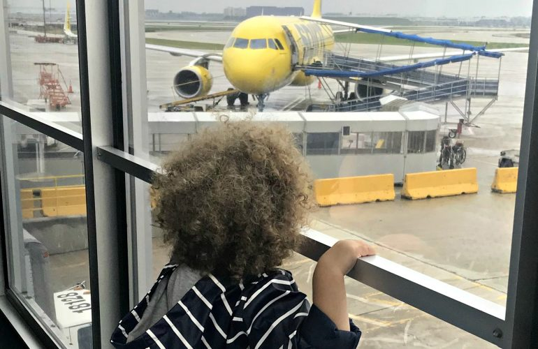 Toddler looking at Spirit Airplane