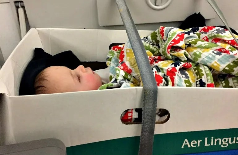 Baby in bassinet on Aerlingus trans-Atlantic flight-surviving jet lag in babies