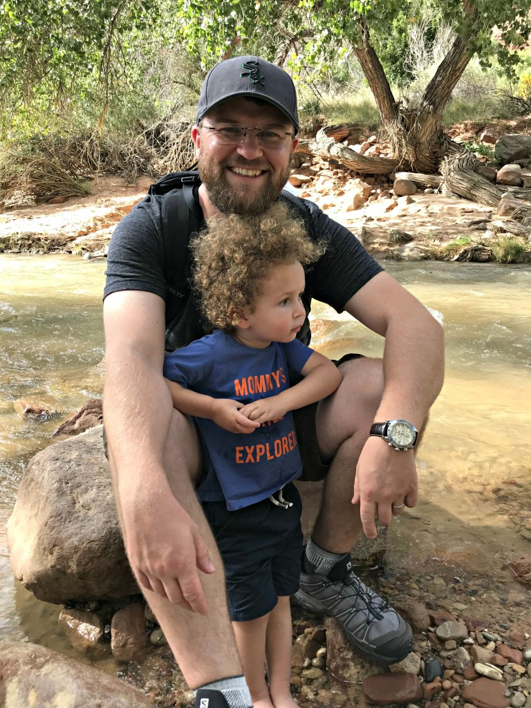 Toddler and father on the banks of the Virgin River in Zion National Park travel with small children