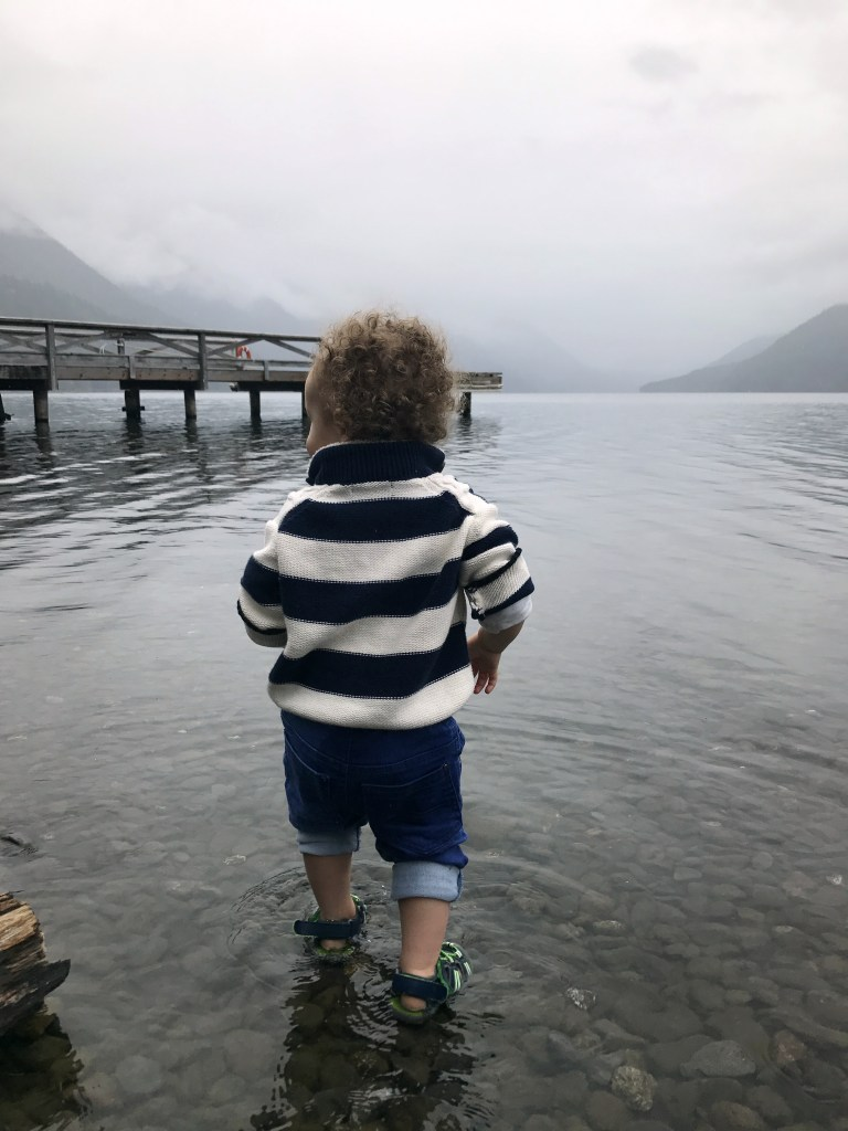 Toddler playing in Lake Crescent at Olympic National Park travel with small children