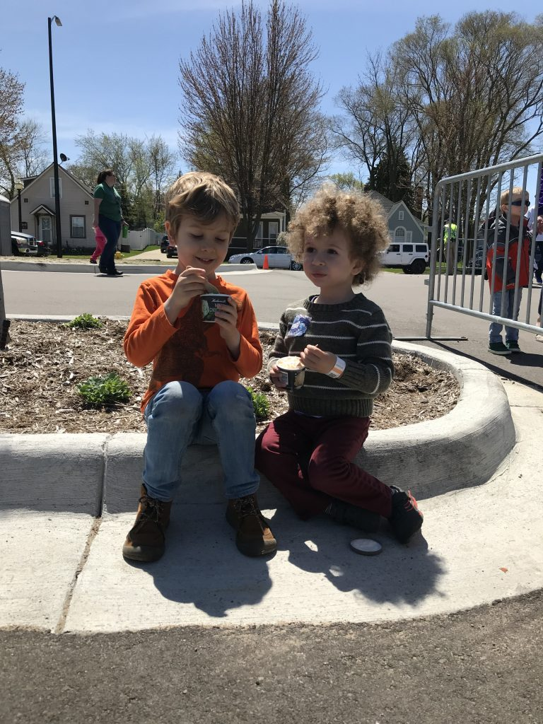 Tulip Time for kids, children enjoying ice cream given out by police officers