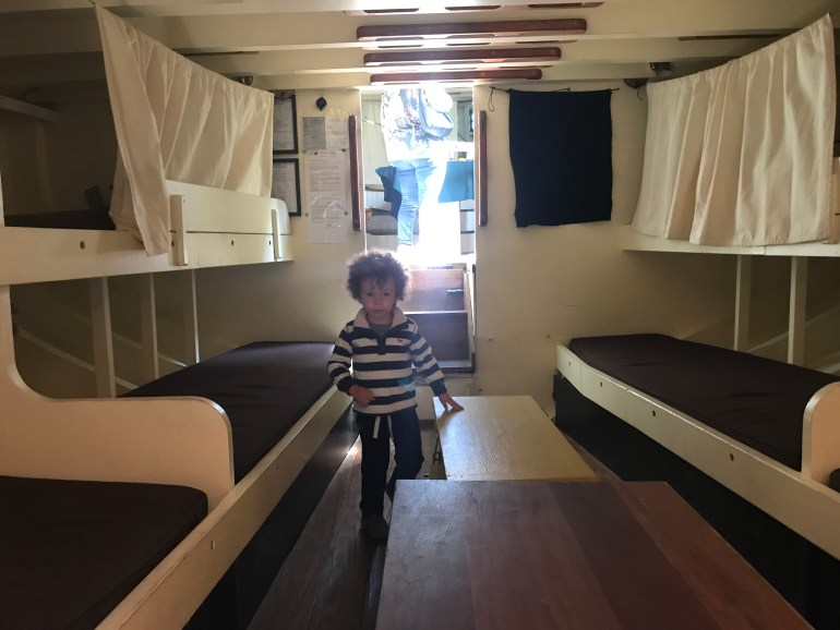 Tulip Time for families, toddler playing below deck on the Friends Good Will tall ship