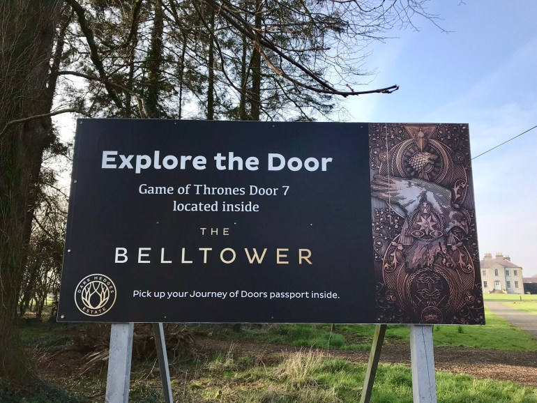 Belltower sign for exploring the door made from the downed beech tree, at Gracehill Hour