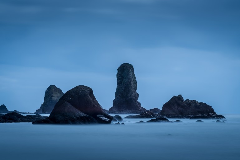 Dramatic sea stacks against a vibrant blue sky off of Taylor Point on Third Beach in Olympic National Park