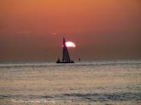 Sailboat silhouette at Scheveningen beach (the Netherlands)
